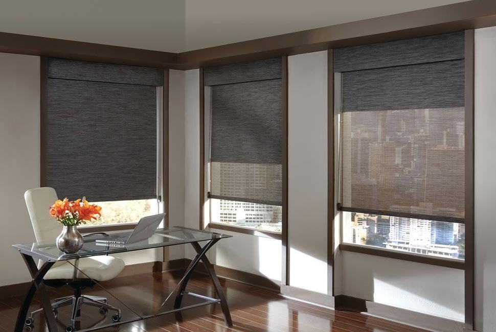 Modern and minimalist office with 3 grey custom window shades by Hunter Douglas