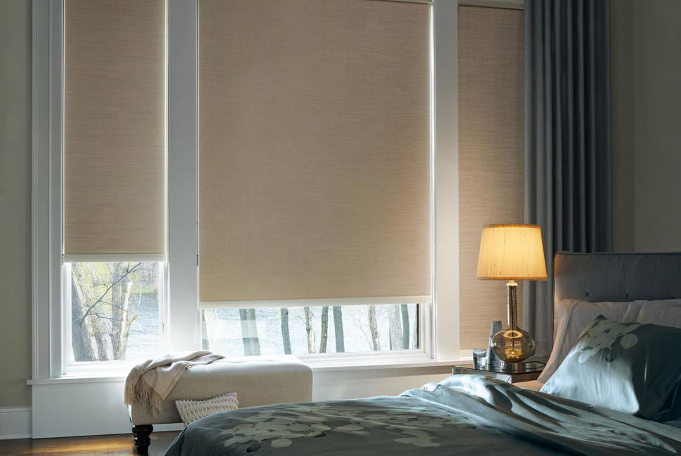 Master bedroom with tall beige custom window shades by Hunter Douglas