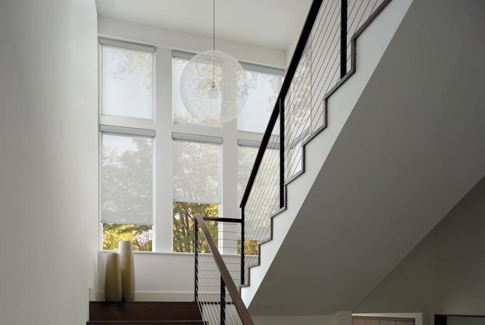 Stairwell with white custom window shades by Hunter Douglas