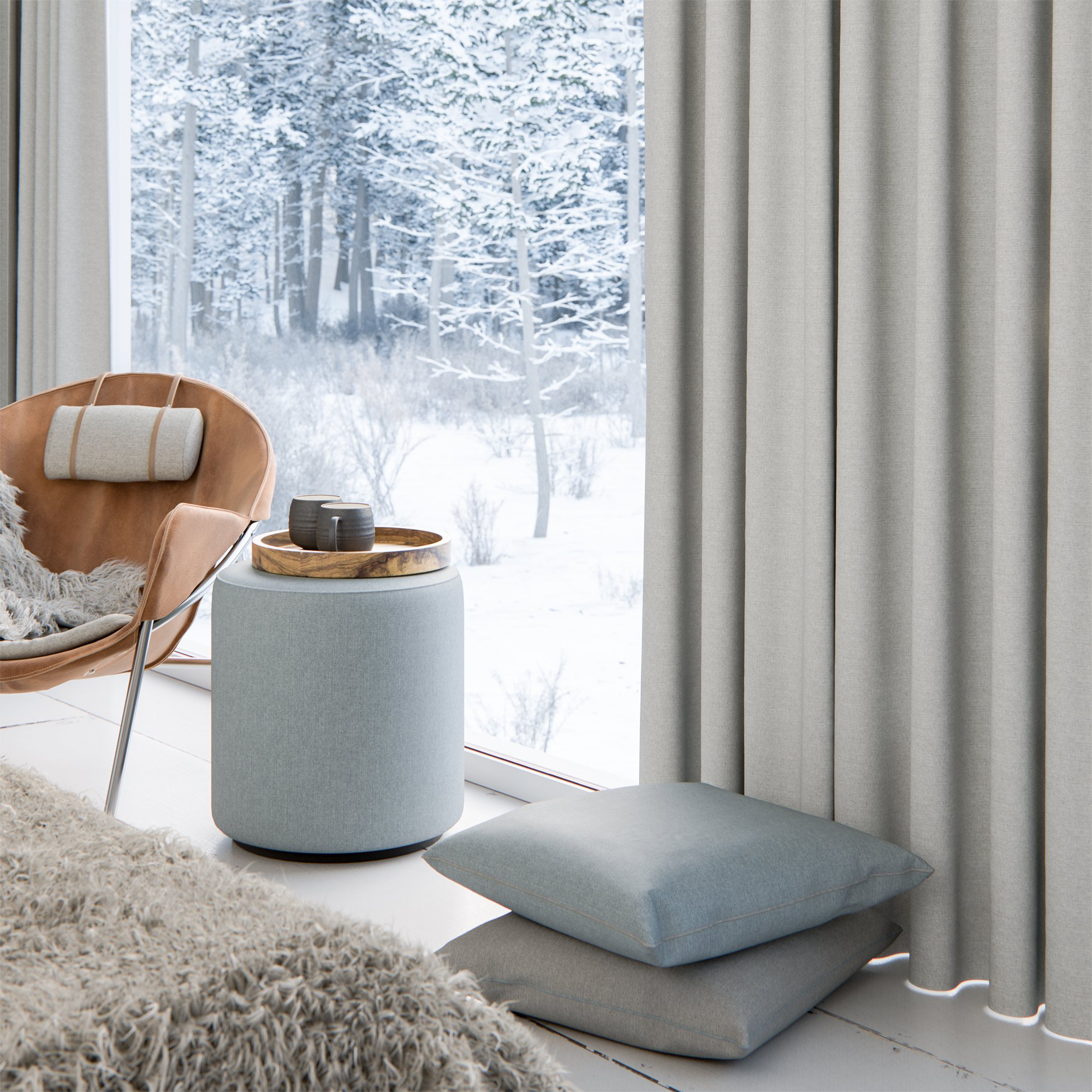 Grey solid blackout curtains in bedroom with cushions, a blue ottoman and fuzzy blanket in the winter