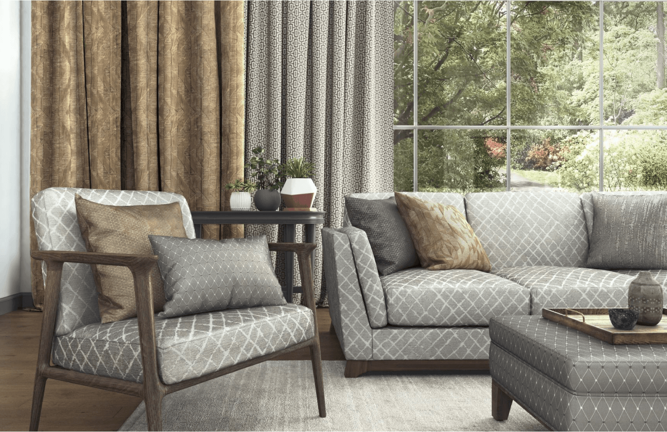 Grey and beige pattern fabric curtains in a living room with matching grey cushions and dark wood floors