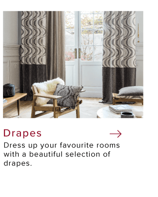Patterned  custom style drapes for tall windows inside a living room